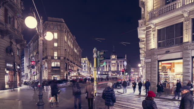 street via monte napoleone, most famous street in milan, time lapes - milano video stock e b–roll
