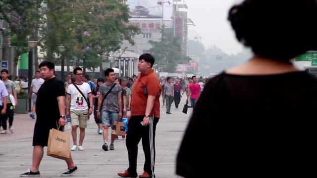 Street view in Wangfujing street at daytime. HD. video