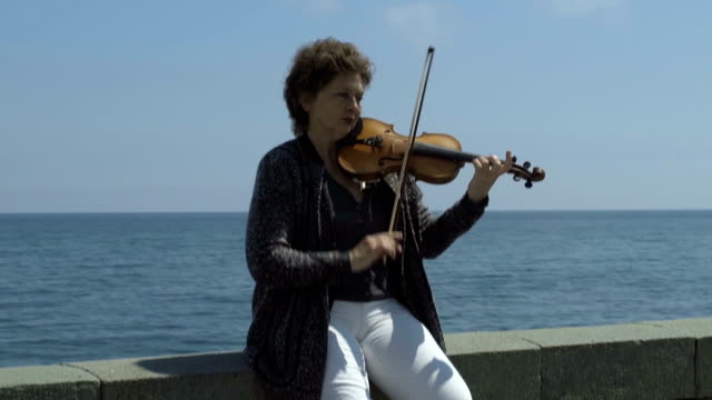 Street Violinist Plays At Seafront video