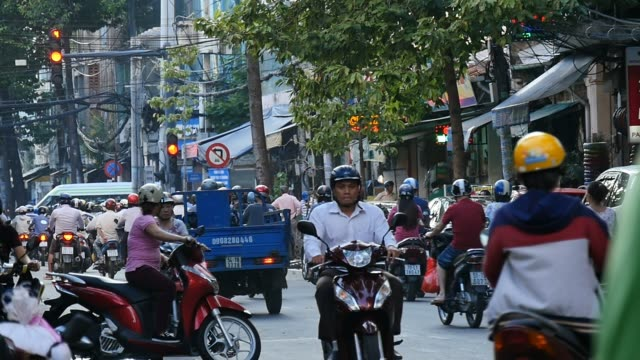 HO CHI MINH / SAIGON, VIETNAM - 2015: Streets busy asian city life slow motion video