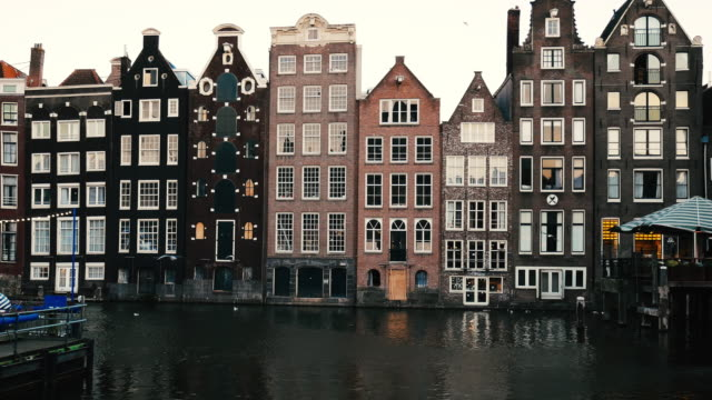 streets of amsterdam, famous bridges, bicycles and architecture in iconic european city in netherlands - dutch architecture stock videos & royalty-free footage