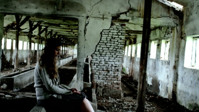 Stress Young Woman Contemplating in Dark Building Depression Concept HD video