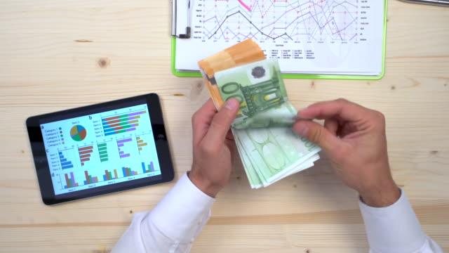 Stressed accountant counting euros