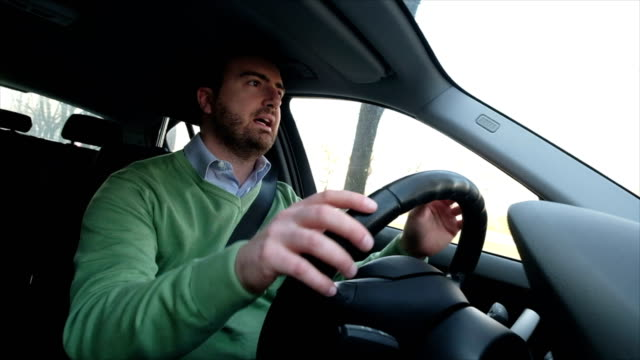 stressed and angry car driver gesturing - rabbia emozione negativa video stock e b–roll