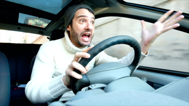 stressed and angry car driver gesturing - furioso video stock e b–roll