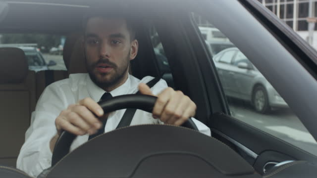 stressed businessman driving a car - driver stock videos and b-roll footage