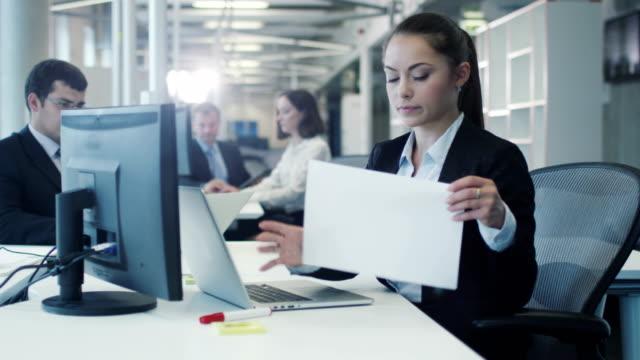Stressed Female Worker Crumpling Documents video