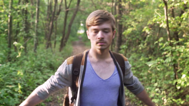 Stressed Man walking in the Forest and calming down video