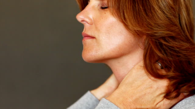 Stressed mature woman with neck pain video