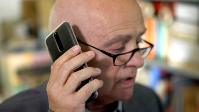 Stressed Overworked Executive Businessman in Suit Calling on Two Phones at Once 60s Caucasian Businessman in Suit landline phone stock videos & royalty-free footage