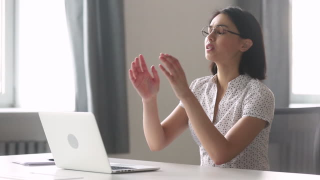 Stressed tired asian businesswoman worker using laptop having computer problem