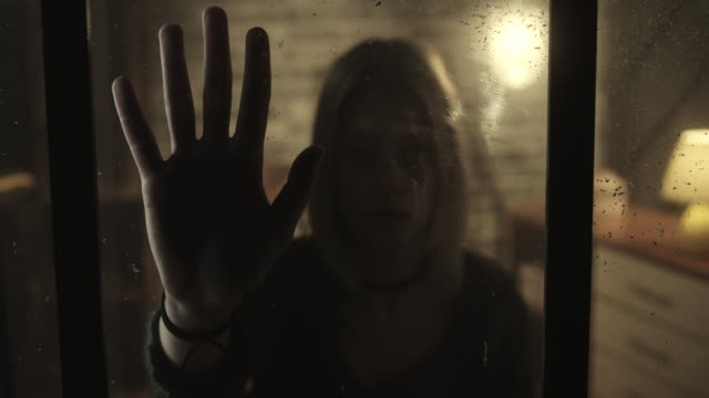 Stressed women holding hand inside of the window video
