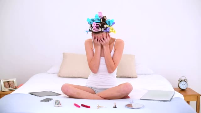 Stressed young girl getting ready on her bed video