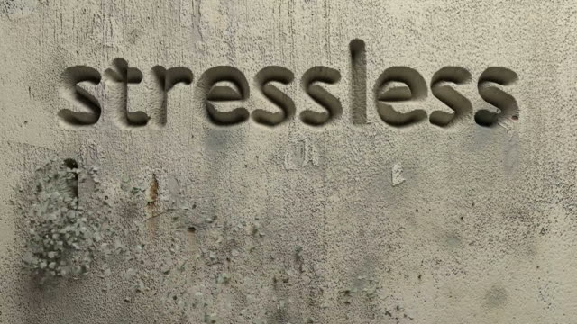 stressless living word carved in a grey wall animation of stressless living word carved in a grey wall mental wellbeing stock videos & royalty-free footage