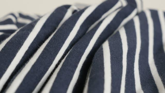 randig blå och vitt tyg prov långsam lutning 4k - kanvas bildbanksvideor och videomaterial från bakom kulisserna