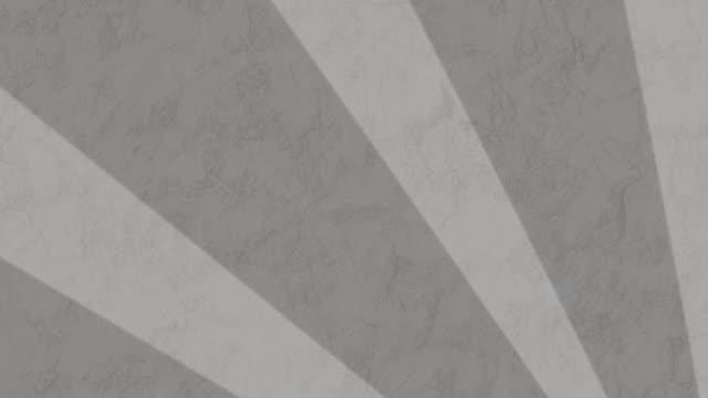 streifen, die sich vor grauem hintergrund drehen und bewegen - begriffssymbol stock-videos und b-roll-filmmaterial