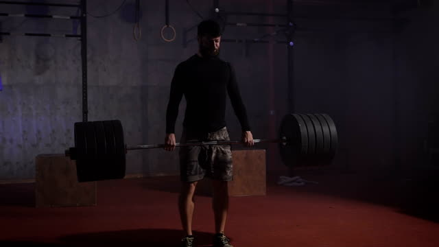 Strong athlete raises the bar with a very large weight video