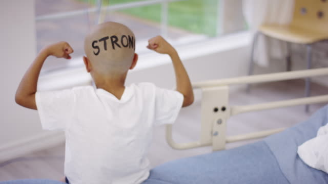 Strong boy undergoing cancer treatment Boy in hospital being strong through treatment cancer patient stock videos & royalty-free footage