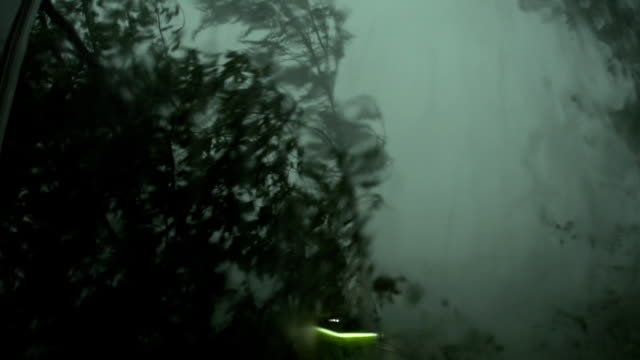 A strong hurricane outside the window