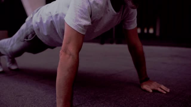Strong senior man doing press up exercises Full press up. Strong sporty aged man doing push up exercises while training in the urban area bodyweight training stock videos & royalty-free footage