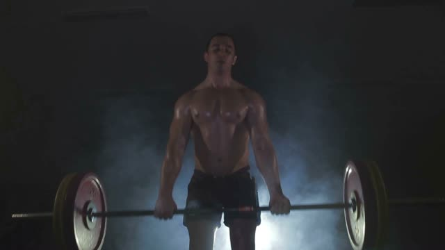 Strong sportsman lifting heavy dumbbells in smoke Strong sportsman lifting heavy dumbbells in smoke 1080p only young women stock videos & royalty-free footage