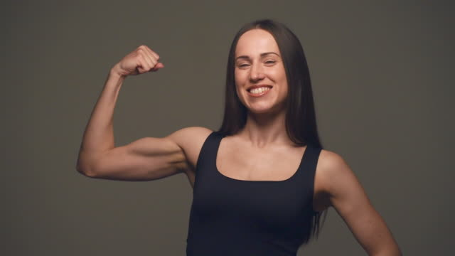 Strong woman showing off biceps video