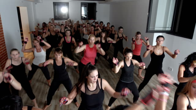 Stronger than ever mixed age group of females are exercising together with piloxing instructor group of people stock videos & royalty-free footage