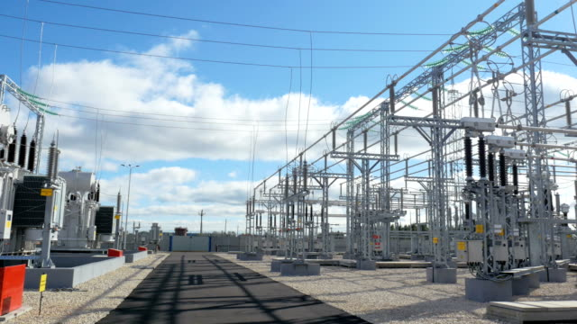 structures hold insulators and equipment on station territory - sottostazione elettrica video stock e b–roll