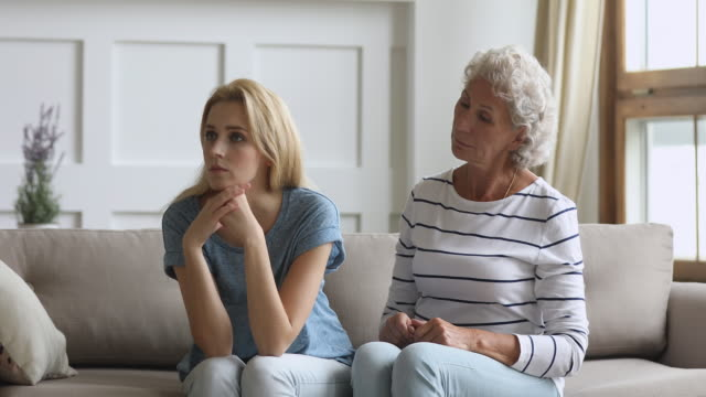 Stubborn young daughter ignore worried senior mother arguing nagging
