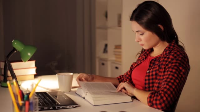 student girl or woman reading book at night home people, education and learning concept - student girl or woman reading book at home at night textbook stock videos & royalty-free footage