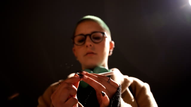 Student girl preparing cannabis for enjoyment Student girl preparing cannabis for enjoyment hashish stock videos & royalty-free footage