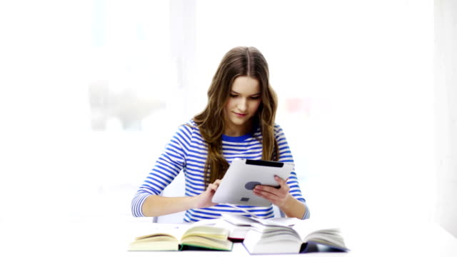student girl with tablet pc and books at home - esame maturità video stock e b–roll