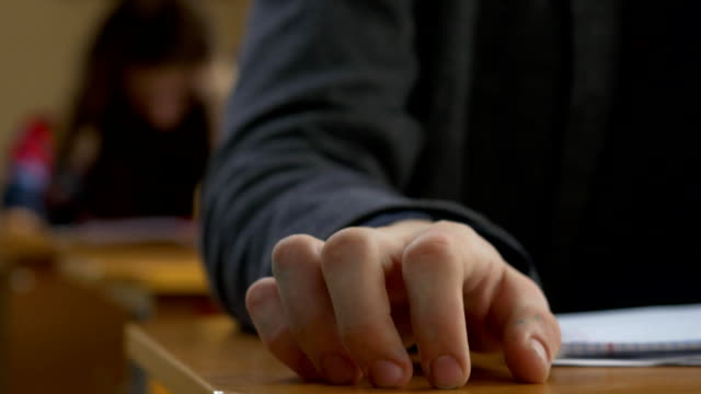 Student hand finger tapping closeup. Young man taps his fingers on a table video