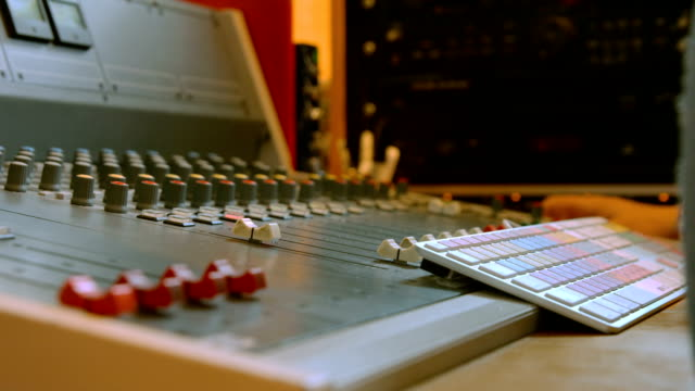 Student mixing music in the studio video