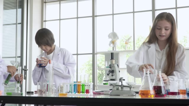 Student of science mixing chemical solution at laboratory