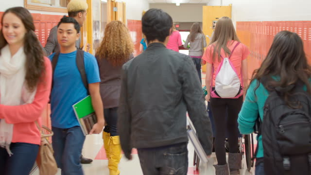 Student runs to class -Uberstock- HD 1080p-  As classes begin, a late student runs down the hallway.  Wide shot.  locker stock videos & royalty-free footage