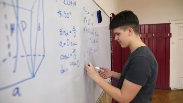 Student solving math problem Student solving math problem mathematics stock videos & royalty-free footage