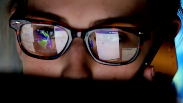 Student watching screen, reflection in glasses   BU CO ED RS