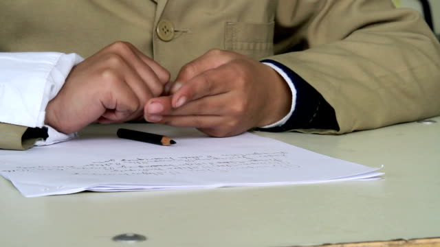 Student writing hands video