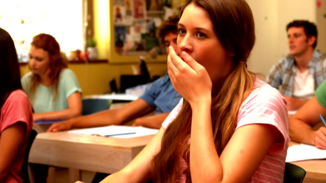 Student yawning in classroom video