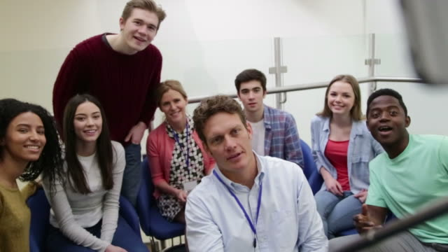 Students And Tutors Taking Portrait With Selfie Stick video