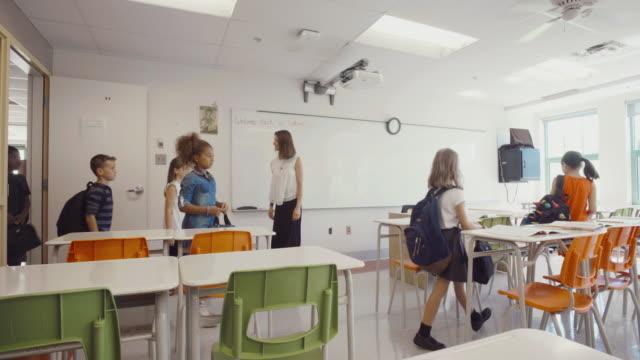 students back to school montage 4k slow motion classroom entering - вход стоковые видео и кадры b-roll
