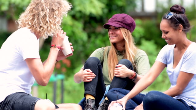 Students chatting at the campus video