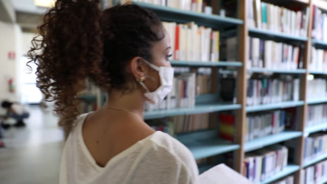 Students focused on the study in a public library video