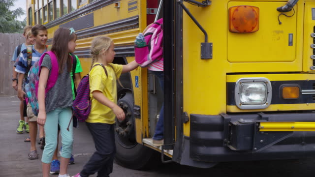 students get onto school bus - school buses stock videos and b-roll footage