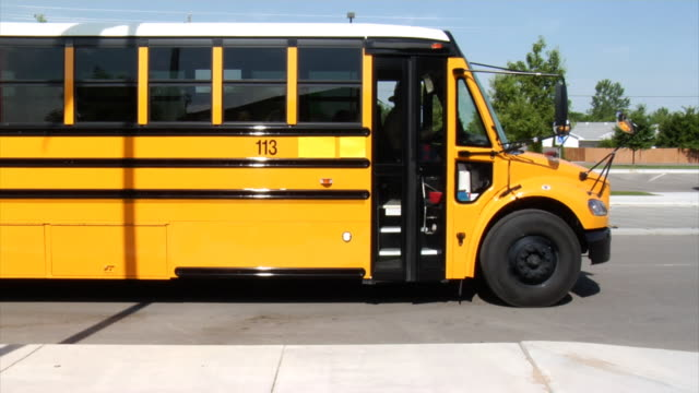 students getting off school bus - school buses stock videos and b-roll footage