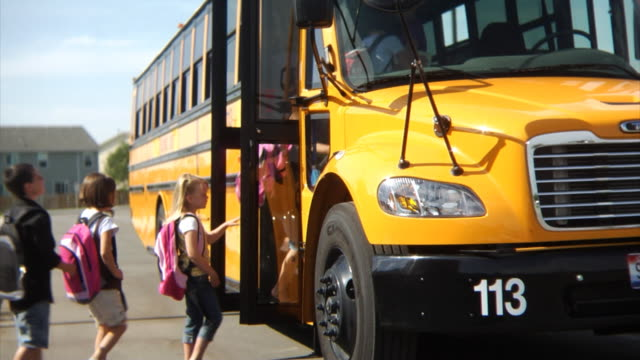students getting on school bus - school buses stock videos and b-roll footage