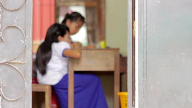 students in ngo orphanage school in cambodia - kamboçya stok videoları ve detay görüntü çekimi