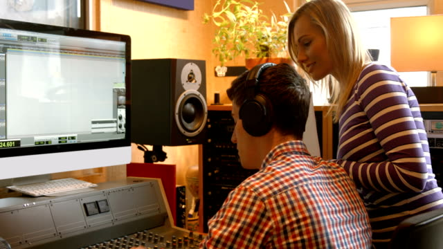 Students mixing music in the studio video