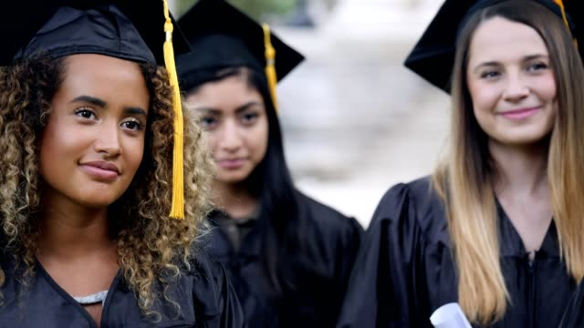 students nod in agreement during graduation keynote speech - student life stock videos & royalty-free footage